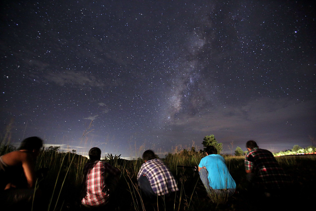 . This long-exposure photograph taken on August 12, 2013 shows people watching for the Perseid meteor shower in the night sky near Yangon. The meteor shower occurs every year in August when the Earth passes through the debris and dust of the Swift-Tuttle comet. Ye Aung Thu/AFP/Getty Images
