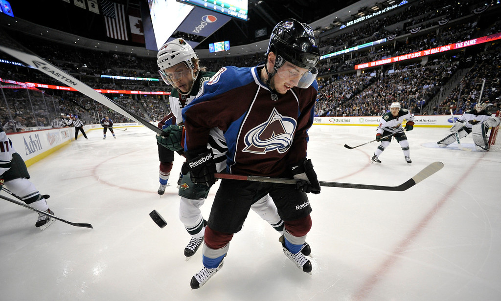 . Minnesota Wild defenseman Jonas Brodin (25) and Colorado Avalanche center Matt Duchene (9) fight for the puck in the corner of the Minnesota Wild zone during the first period.  (Photo by John Leyba/The Denver Post)
