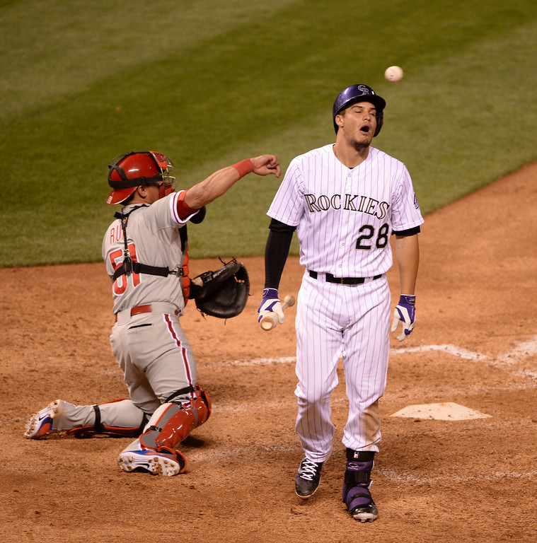 . DENVER, CO - APRIL 18: Colorado batter Nolan Arenado (28) reacted after he struck out in the eighth inning. The Colorado Rockies defeated the Philadelphia Phillies 12-1 Friday night, April 18, 2014 at Coors Field.  (Photo by Karl Gehring/The Denver Post)
