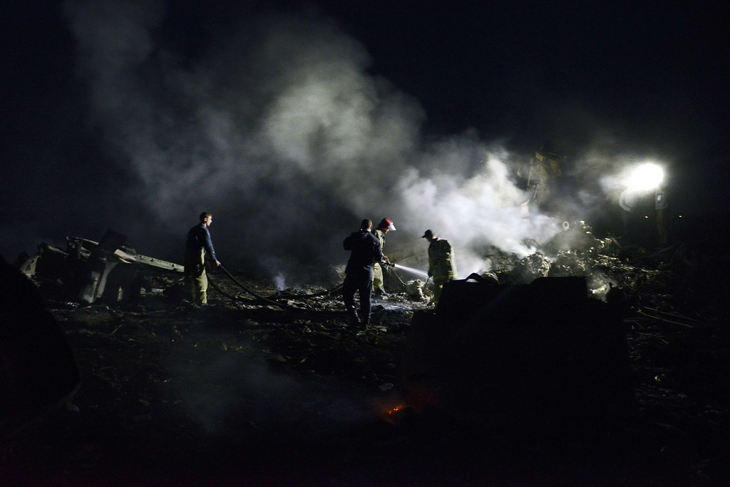 ". Firefighters extinguish a fire, on July 17, 2014, amongst the wreckages of the malaysian airliner carrying 295 people from Amsterdam to Kuala Lumpur after it crashed, near the town of Shaktarsk, in rebel-held east Ukraine. Ukrainian President Petro Poroshenko said on Thursday that the Malaysia Airlines jet that crashed over rebel-held eastern Ukraine may have been shot down.""We do not exclude that the plane was shot down and confirm that the Ukraine Armed Forces did not fire at any targets in the sky,\"" Poroshenko said in a statement posted on the president\'s website. AFP PHOTO/ ALEXANDER  KHUDOTEPLY/AFP/Getty Images"