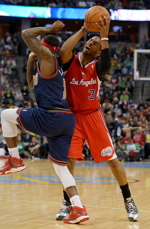 . Denver Nuggets guard Ty Lawson (3) commits a foul as he runs in to Los Angeles Clippers guard Chris Paul (3) during the third quarter. (Photo by John Leyba/The Denver Post)