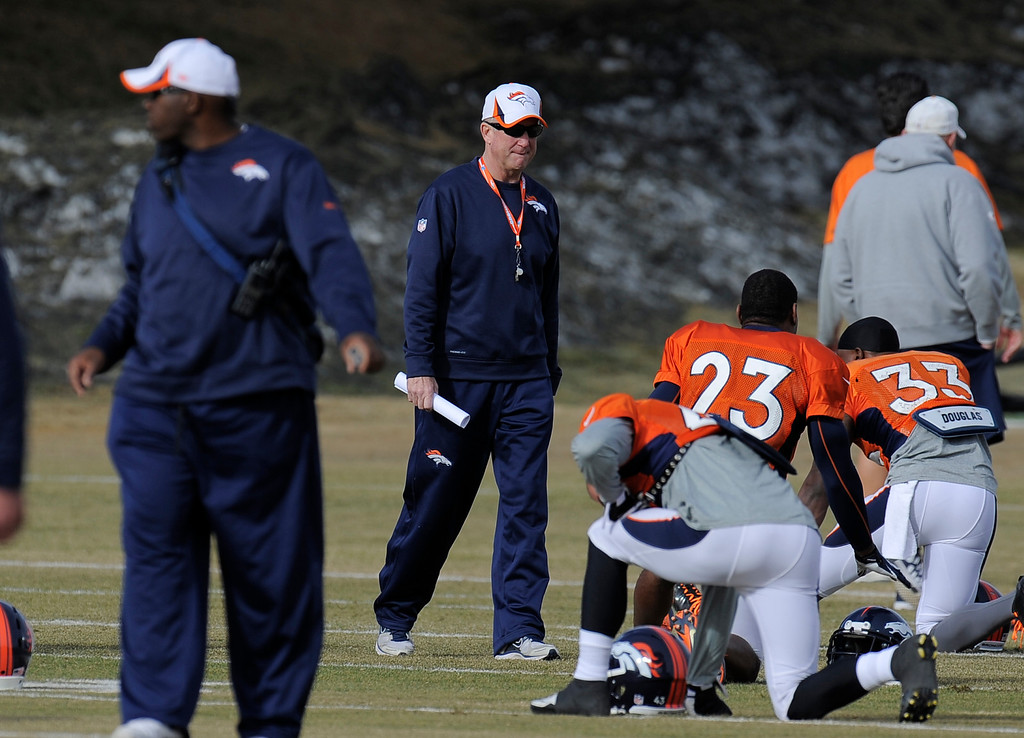 . Denver Broncos head coach John Fox walks on the field before practice December 18, 2013 at Dove Valley (Photo by John Leyba/The Denver Post)