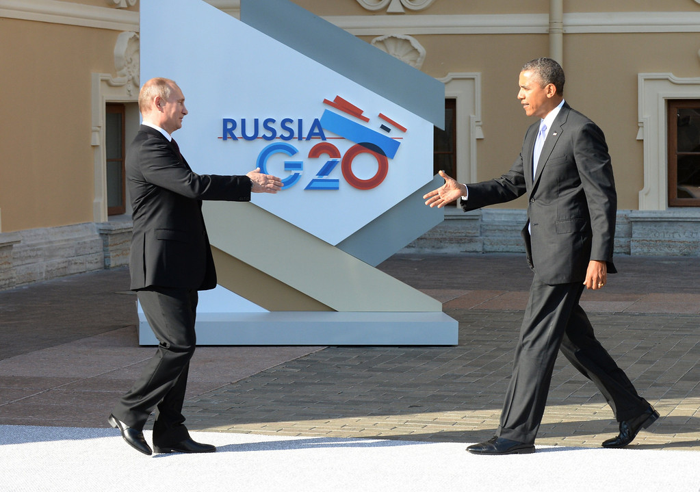 . Russias President Vladimir Putin (L) welcomes US President Barack Obama at the start of the G20 summit on September 5, 2013 in Saint Petersburg. Russia hosts the G20 summit hoping to push forward an agenda to stimulate growth but with world leaders distracted by divisions on the prospect of US-led military action in Syria.      AFP PHOTO / YURI  KADOBNOV/AFP/Getty Images