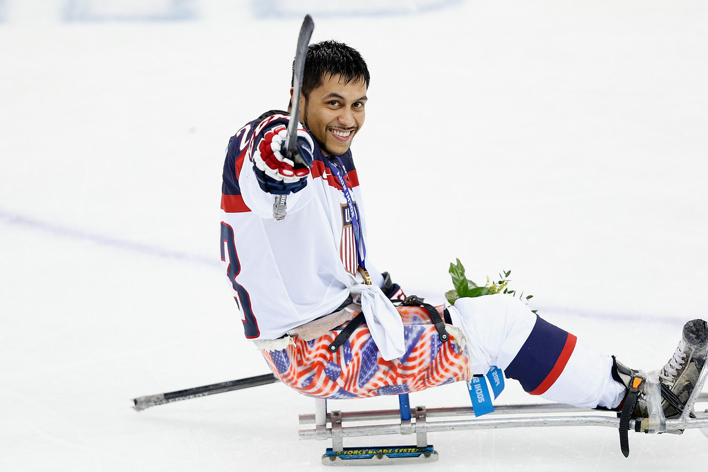 . Rico Roman of USA celebrates after winning the Ice Sledge Hockey Gold Medal match between Russia and USA at the Shayba Arena during day eight of the 2014 Paralympic Winter Games on March 15, 2014 in Sochi, Russia.  (Photo by Harry Engels/Getty Images)