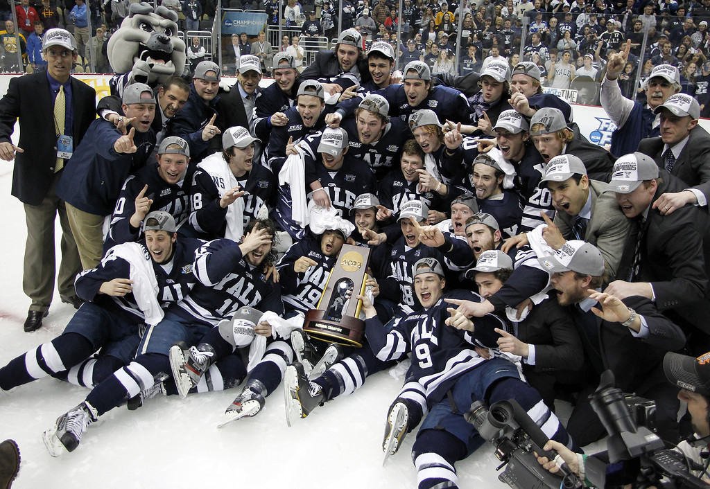 . PITTSBURGH, PA - APRIL 13:  The Yale Bulldogs pose for a team photo after defeating the Quinnipiac Bobcats in the Men\'s Ice Hockey National Championship game at Consol Energy Center on April 13, 2013 in Pittsburgh, Pennsylvania.  (Photo by Justin K. Aller/Getty Images)