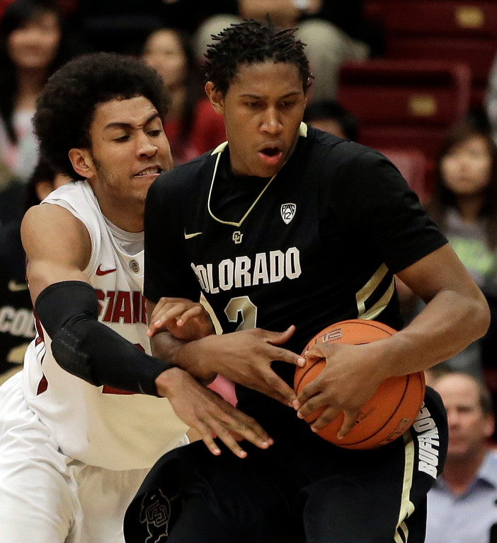 . Colorado\'s Xavier Johnson, right, keeps the ball from Stanford\'s Josh Huestis during the second half of an NCAA college basketball game Wednesday, Feb. 27, 2013, in Stanford, Calif. (AP Photo/Ben Margot)