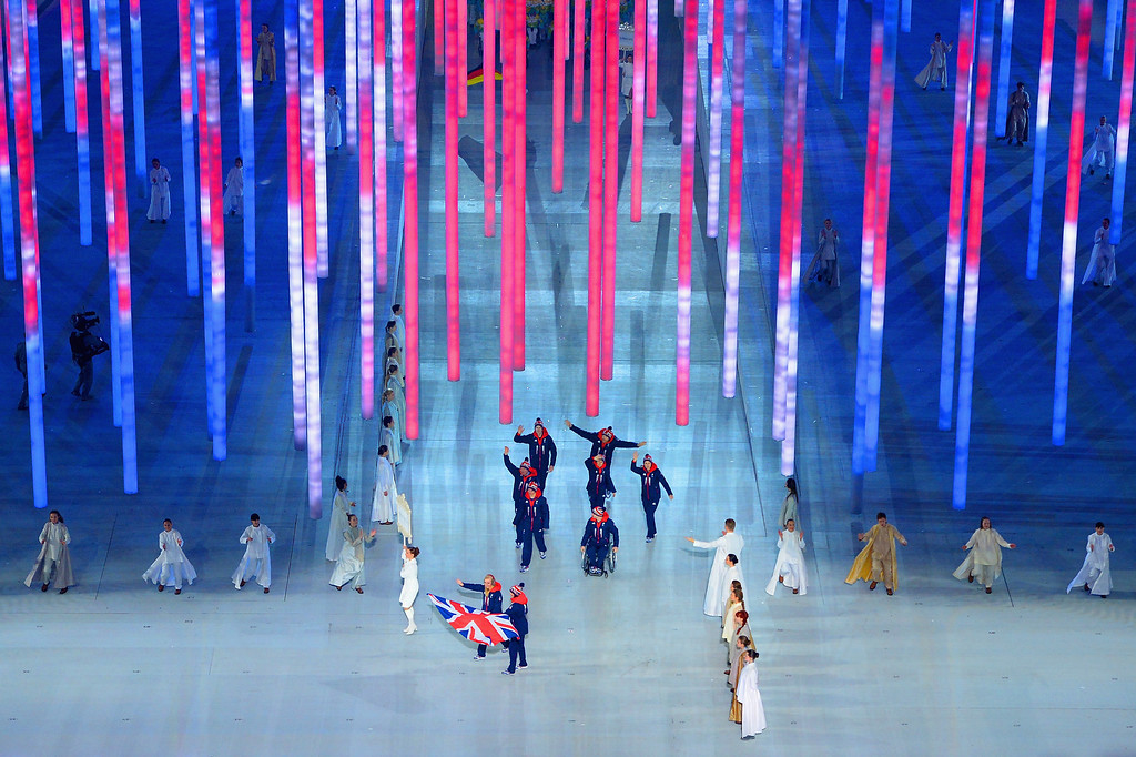 . Alpine skier Millie Knight of Great Britain bears the flag during the Opening Ceremony of the Sochi 2014 Paralympic Winter Games at Fisht Olympic Stadium on March 7, 2014 in Sochi, Russia.  (Photo by Dennis Grombkowski/Getty Images)