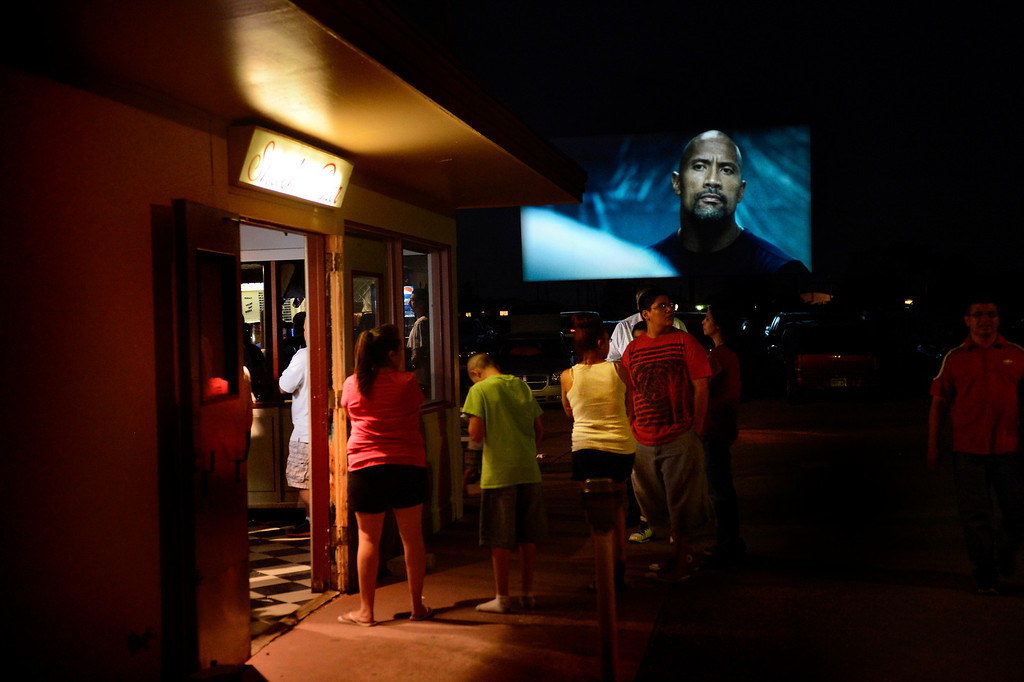 . PUEBLO, CO. - May 24: The line stretches out the doors of the snack bar even after the movie has started at the Mesa Drive In in Pueblo. Service is steady and fast paced through most of the night at the filled drive in.  May 24, 2013 Pueblo, Colorado. (Photo By Joe Amon/The Denver Post)