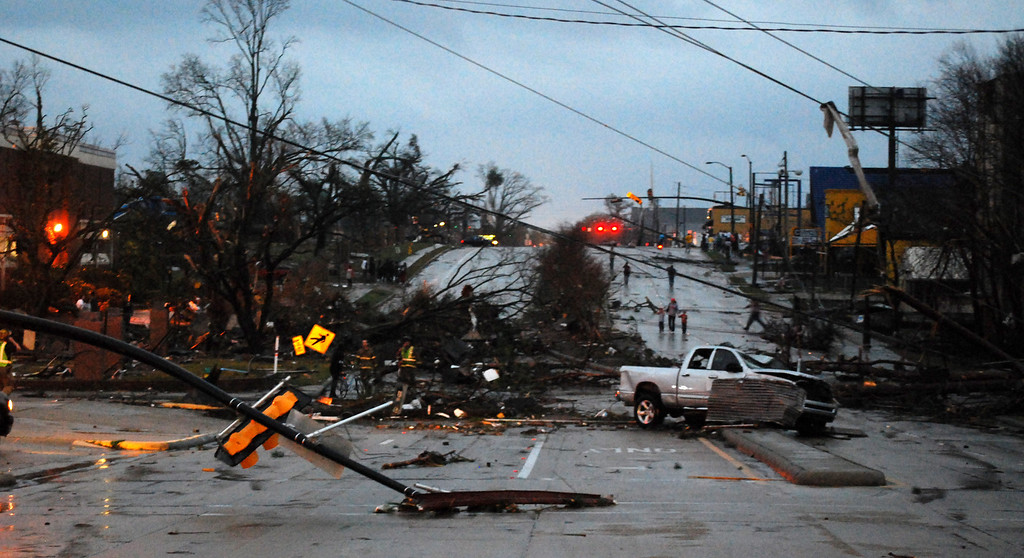 . Hardy Street in front of the University of Southern Mississippi campus is obstructed by debris blown by an apparent tornado in Hattiesburg, Miss., Sunday, Feb. 10, 2013. (AP Photo/The Student Printz, Jana Edwards)