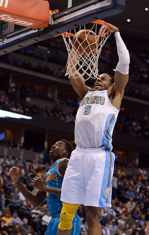 . DENVER, CO. - FEBRUARY 01: Andre Iguodala of Denver Nuggets #9 dunks over Al Farouq Aminu of New Orleans Hornets #0 in the 2nd half of the game on February 1, 2013 at the Pepsi Center in Denver, Colorado. (Photo By Hyoung Chang/The Denver Post)