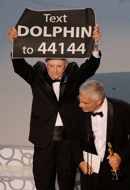 ". Animal activist Ric O\'Barry (L) and director Louie Psihoyos accept Best Documentary Feature award for ""The Cove\"" onstage during the 82nd Annual Academy Awards held at Kodak Theatre on March 7, 2010 in Hollywood, California.  (Photo by Kevin Winter/Getty Images)"