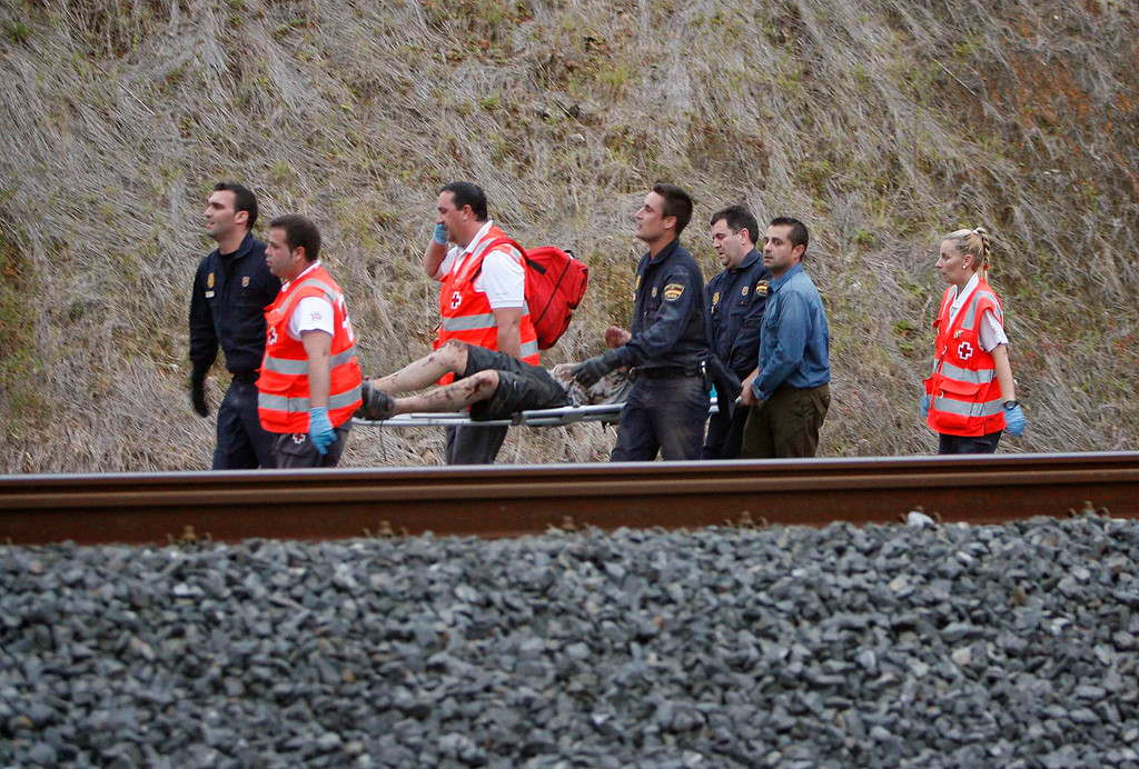. A man is evacuated by emergency personnel at the scene of a train derailment in Santiago de Compostela, Spain, on Wednesday, July 24, 2013.  (AP Photo/ El correo Gallego/Antonio Hernandez)