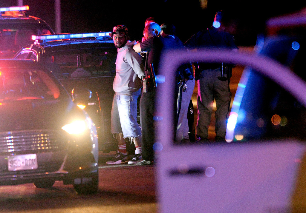 . Police put rapper Schoolboy Q in handcuffs during an investigation into a shooting that occurred at Red Rocks Amphitheater Thursday night, June 19, 2014. Three individuals in a Chevy Suburban stopped by police at 7th Avenue and Kalamath Street were taken to a hospital with gunshot wounds. Photo by Karl Gehring/The Denver Post
