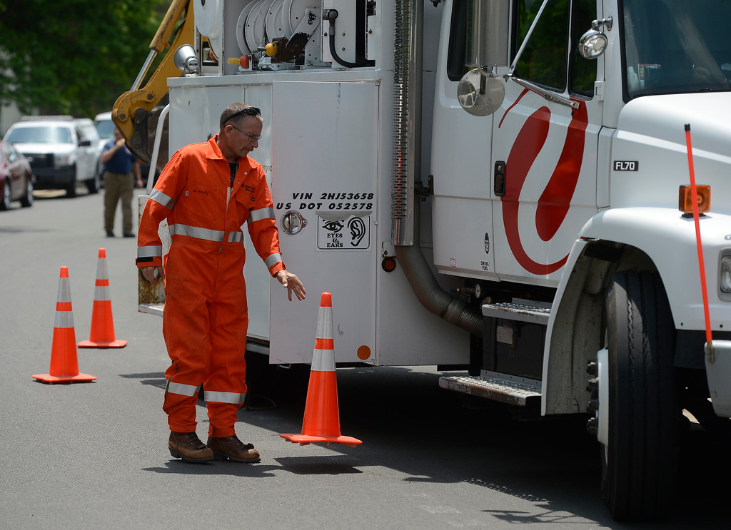 . An Xcel Energy worker sets up near the scene of a house explosion on the 9300 block of Ingalls Street in Westminster, Colorado, Thursday afternoon June 13, 2013.  (Photo By Andy Cross/The Denver Post)