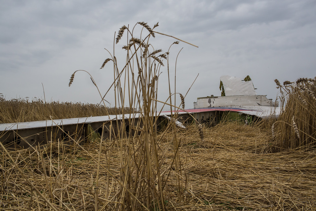 . The tail from an Air Malaysia plane crash lies in a wheat field on July 18, 2014 in Grabovka, Ukraine. Air Malaysia flight MH17 travelling from Amsterdam to Kuala Lumpur crashed yesterday on the Ukraine/Russia border near the town of Shaktersk. The Boeing 777 was carrying 298 people including crew members, the majority of the passengers being Dutch nationals, believed to be at least 173, 44 Malaysians, 27 Australians, 12 Indonesians and 9 Britons. It has been speculated that the passenger aircraft was shot down by a surface to air missile by warring factions in the region.   (Photo by Brendan Hoffman/Getty Images)
