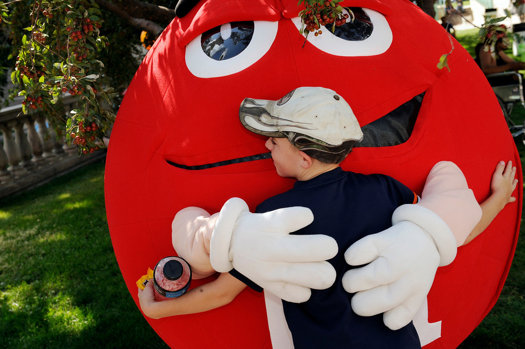 . Michael Whitcomb, age 11, from Aurora, hugged a giant chocolate candy at the Taste of Colorado, Saturday afternoon, August 30, 2008.    Karl Gehring/The Denver Post