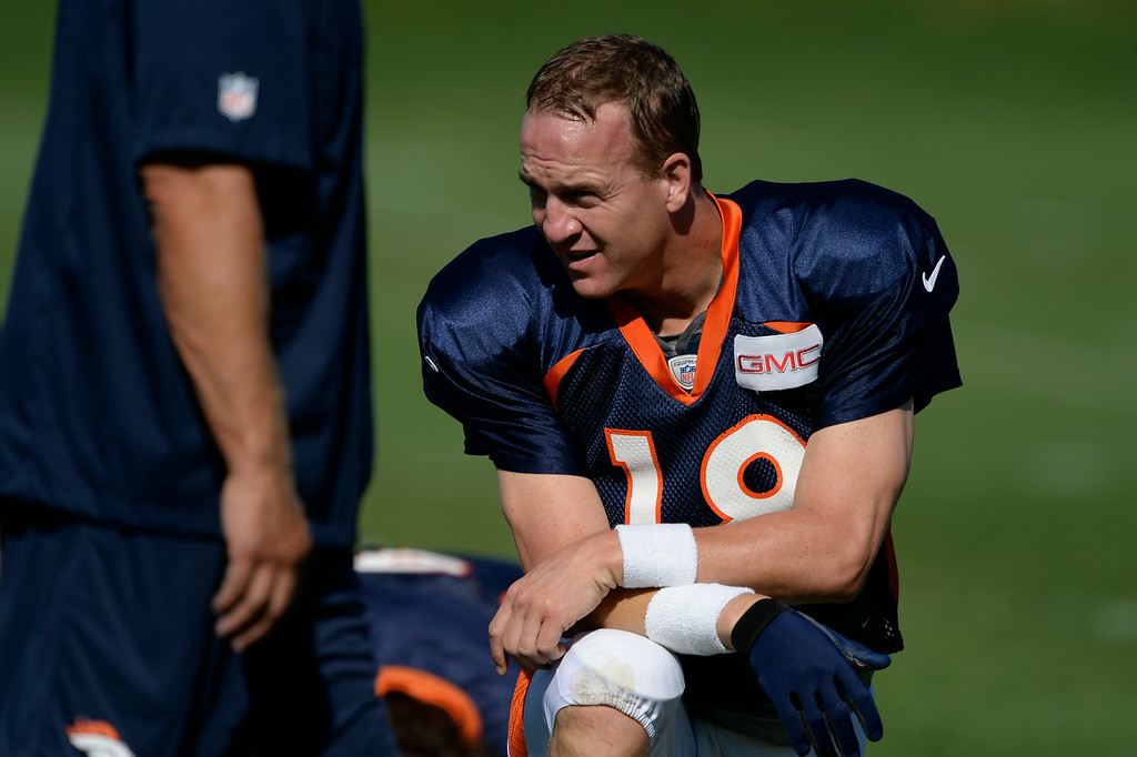 . Denver Broncos quarterback Peyton Manning (18) stretches before practice at the Denver Broncos 2014 training camp August 12, 2014 at Dove Valley. (Photo by John Leyba/The Denver Post)