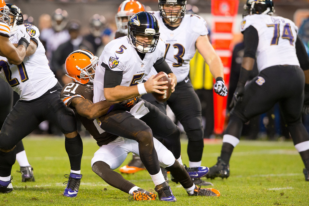 . Cornerback Chris Owens #21 of the Cleveland Browns sacks quarterback Joe Flacco #5 of the Baltimore Ravens during the first half at FirstEnergy Stadium on November 3, 2013 in Cleveland, Ohio. (Photo by Jason Miller/Getty Images)