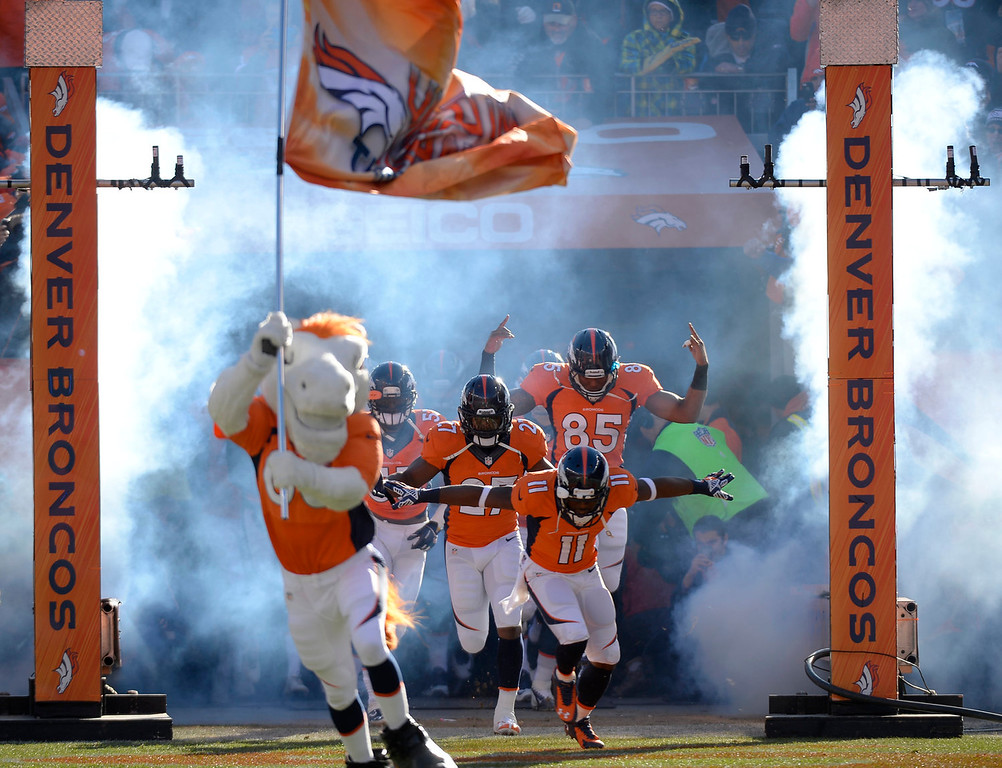 . Led by Denver Broncos wide receiver Trindon Holliday (11) The Denver Broncos takes the field at the start of the game. The Denver Broncos vs. The San Diego Chargers in an AFC Divisional Playoff game at Sports Authority Field at Mile High in Denver on January 12, 2014. (Photo by John Leyba/The Denver Post)