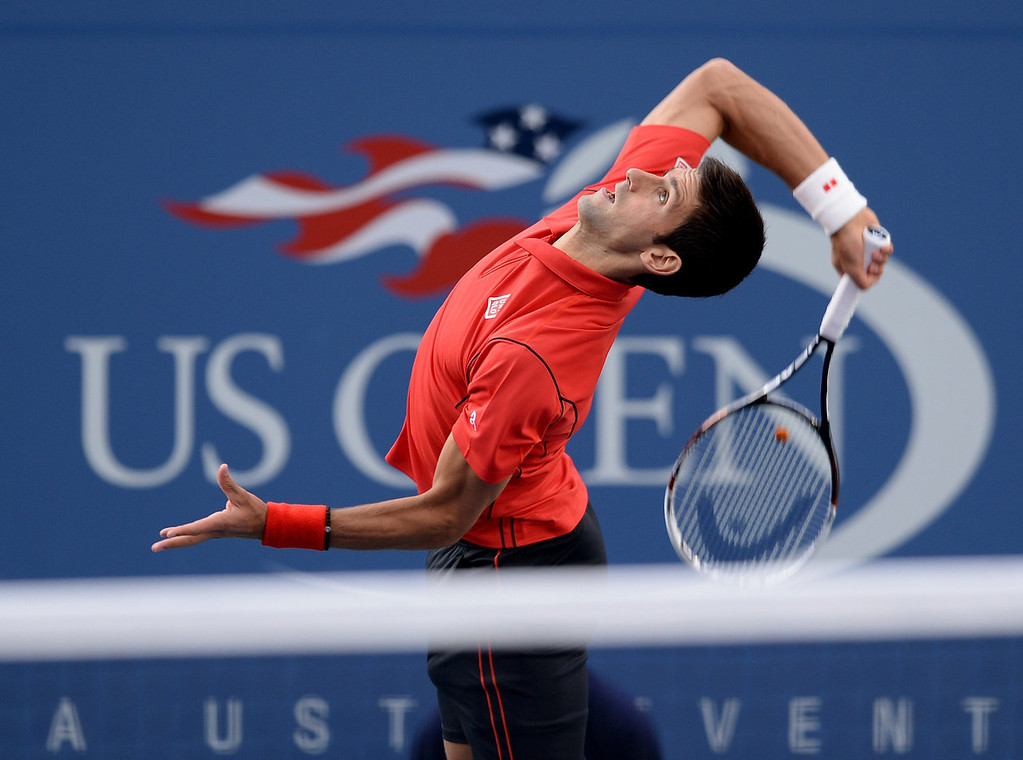 . Novak Djokovic of Serbia serves to Rafael Nadal of Spain during the 2013 US Open men\'s singles final at the USTA Billie Jean King National Tennis Center September 9, 2013 in New York.   STAN HONDA/AFP/Getty Images