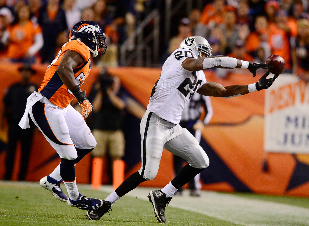 . Oakland Raiders running back Darren McFadden (20) has a pass go right through his hands in the second quarter. The Denver Broncos took on the Oakland Raiders at Sports Authority Field at Mile High in Denver on September 23, 2013. (Photo by AAron Ontiveroz/The Denver Post)