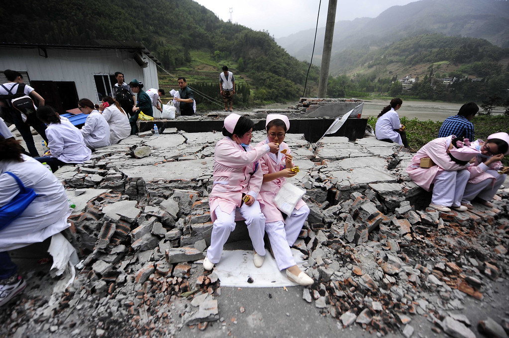 . This photo taken on April 21, 2013 shows the medical personnel having a rest in disaster-hit Ya\'an, southwest China\'s Sichuan province.  STR/AFP/Getty Images