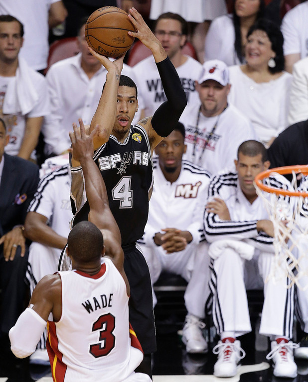 . San Antonio Spurs\' Danny Green (4) shoots over Miami Heat\'s Dwyane Wade (3) during the first half in Game 7 of the NBA basketball championships, Thursday, June 20, 2013, in Miami. (AP Photo/Wilfredo Lee)