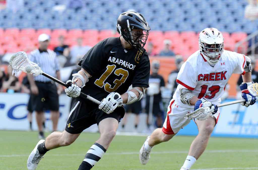 . DENVER, CO. - MAY 18 : Kiely O\'Connor (13) of Arapahoe High School, left, controls the ball against John Eansor of Cherry Creek High School (13) during 5A Boy\'s Lacrosse Championship game at Sports Authority Field at Mile High Stadium. Denver, Colorado. May 18, 2013. Arapahoe won 10-7. (Photo By Hyoung Chang/The Denver Post)