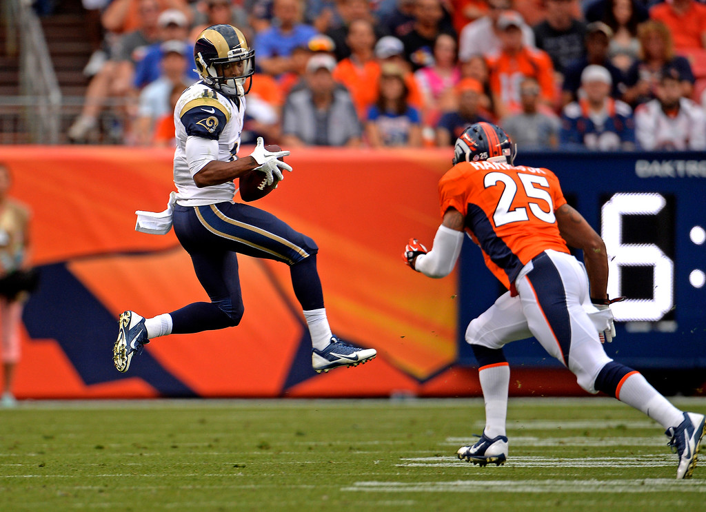 . DENVER, CO. - August 24: Wide receiver Tavon Austin (11) of the St. Louis Rams catches the ball across the middle in front of cornerback Chris Harris (25) of the Denver Broncosduring the 3rd pre-season game of the season at Sports Authority Field at Mile High. August 24, 2013 Denver, Colorado. (Photo By Joe Amon/The Denver Post)