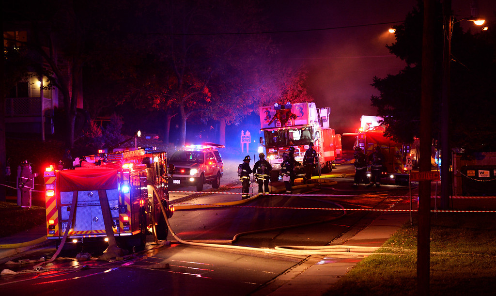 ". Fire crews set up along Estes Street near Alameda Boulevard in Lakewood, October 22, 2013. Firefighters responded to four separate fires in Lakewood early Tuesday morning that they are calling ""suspicious.\"" (Photo By RJ Sangosti/The Denver Post)"