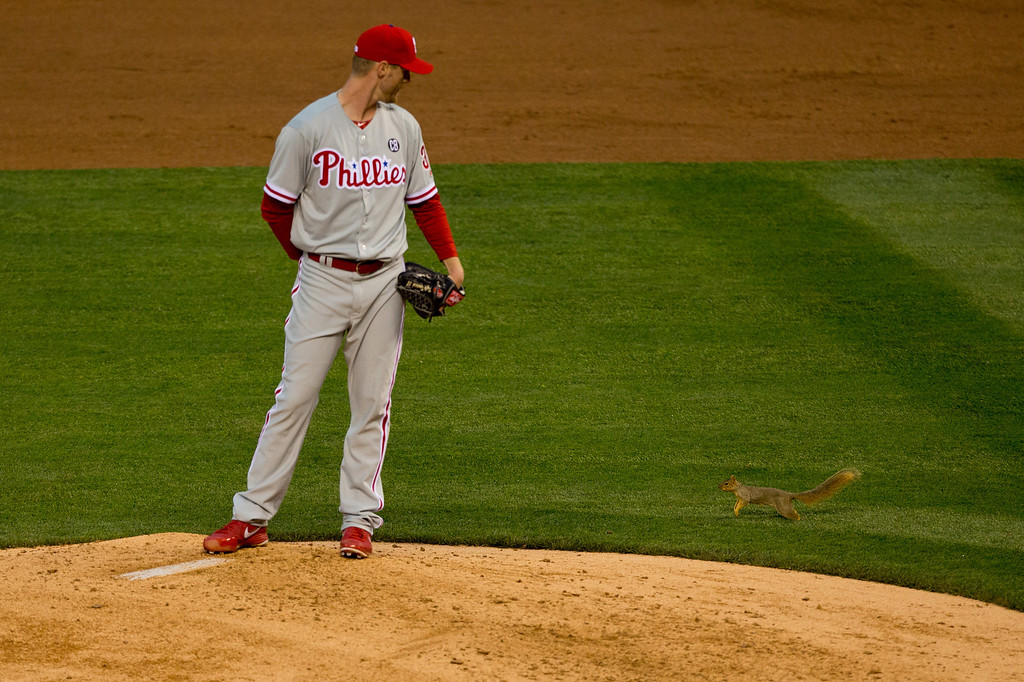 . Starting pitcher Kyle Kendrick #38 of the Philadelphia Phillies watches as a squirrel causes a delay in play during the third inning against the Colorado Rockies at Coors Field on April 19, 2014 in Denver, Colorado.  (Photo by Justin Edmonds/Getty Images)
