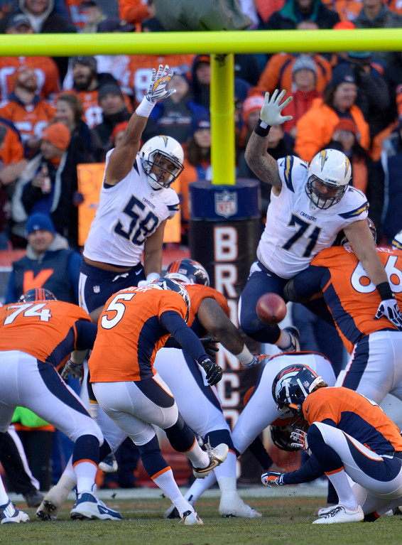 . Denver Broncos kicker Matt Prater (5) kicks the extra point during the second quarter. The Denver Broncos vs. The San Diego Chargers in an AFC Divisional Playoff game at Sports Authority Field at Mile High in Denver on January 12, 2014. (Photo by Joe Amon/The Denver Post)