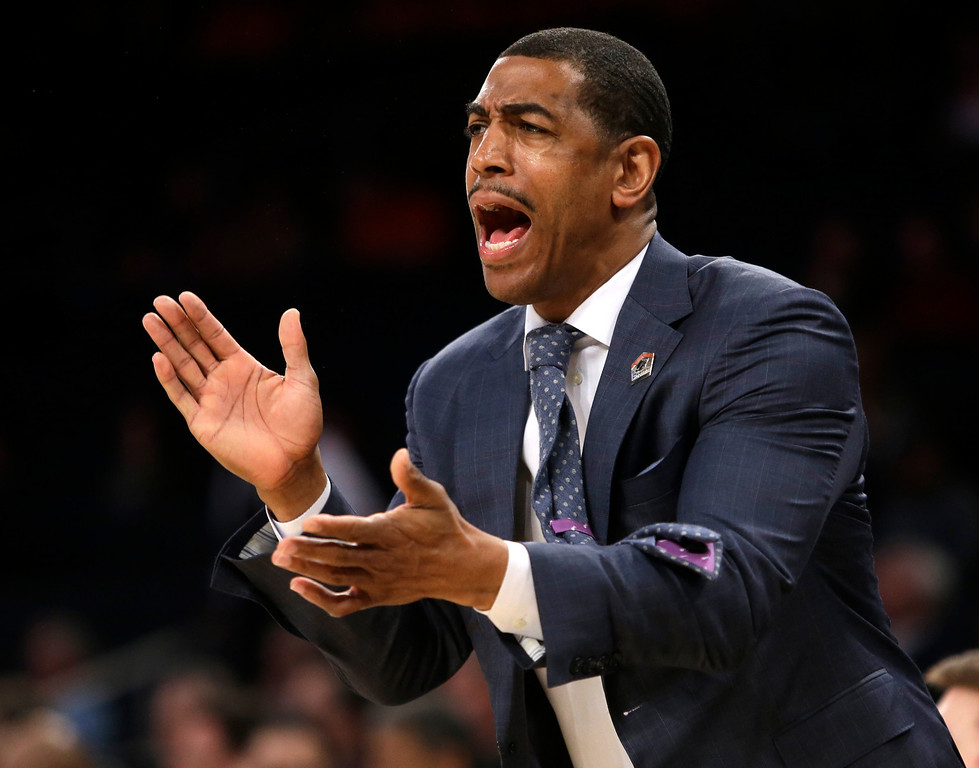 . Connecticut coach Kevin Ollie shouts instructions during the first half in a regional semifinal against Iowa State in the NCAA men\'s college basketball tournament Friday, March 28, 2014, in New York. (AP Photo/Frank Franklin II)