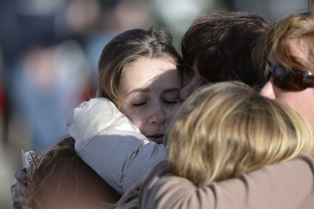 . CENTENNIAL, CO. - DECEMBER 13: A mother and daughter are reunited at a Burger King near Arapahoe High School in Centennial, CO December 13, 2013. A student who carried a shotgun into Arapahoe High School and asked where to find a specific teacher opened fire on Friday, wounding two fellow students before apparently killing himself, Arapahoe County Sheriff Grayson Robinson said. (Photo By Craig F. Walker / The Denver Post)