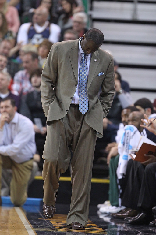 . Utah Jazz head coach Tyrone Corbin looks down at the floor in the second half during an NBA basketball game against the Denver Nuggets Monday, Nov. 11, 2013, in Salt Lake City.  The Denver Nuggets won 100-81. (AP Photo/Rick Bowmer)