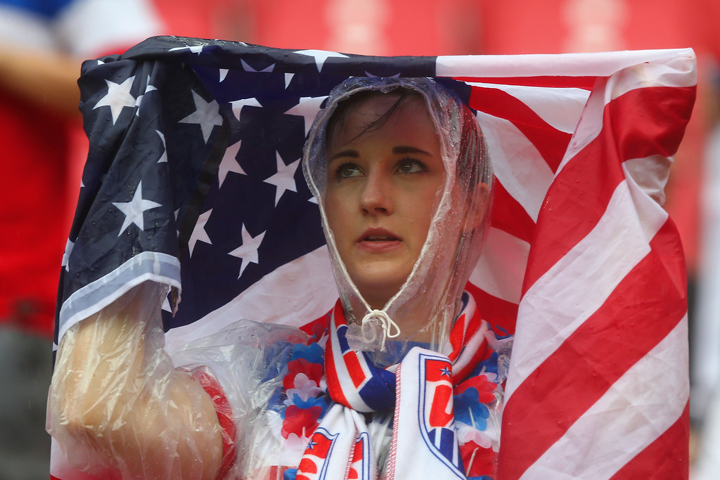 . A United States fan looks on in the rain prior to the 2014 FIFA World Cup Brazil group G match between the United States and Germany at Arena Pernambuco on June 26, 2014 in Recife, Brazil.  (Photo by Martin Rose/Getty Images)