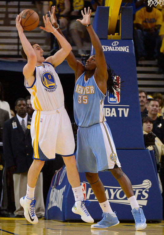 . Kenneth Faried (35) of the Denver Nuggets gets his arms up on Klay Thompson (11) of the Golden State Warriors during the second quarter in Game 6 of the first round NBA Playoffs May 2, 2013 at Oracle Arena. (Photo By John Leyba/The Denver Post)