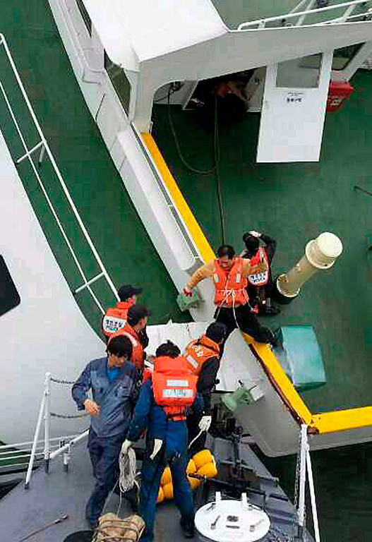 . In this photo released by South Korea Coast Guard via Yonhap News Agency, South Korean coast guard rescue passengers from a ferry in the water off the southern coast near Jindo, South Korea, Wednesday, April 16, 2014. The ferry carrying 459 people, mostly high school students on an overnight trip to a tourist island, sank off South Korea\'s southern coast on Wednesday, leaving nearly 300 people missing despite a frantic, hours-long rescue by dozens of ships and helicopters. (AP Photo/South Korea Coast Guard via Yonhap)