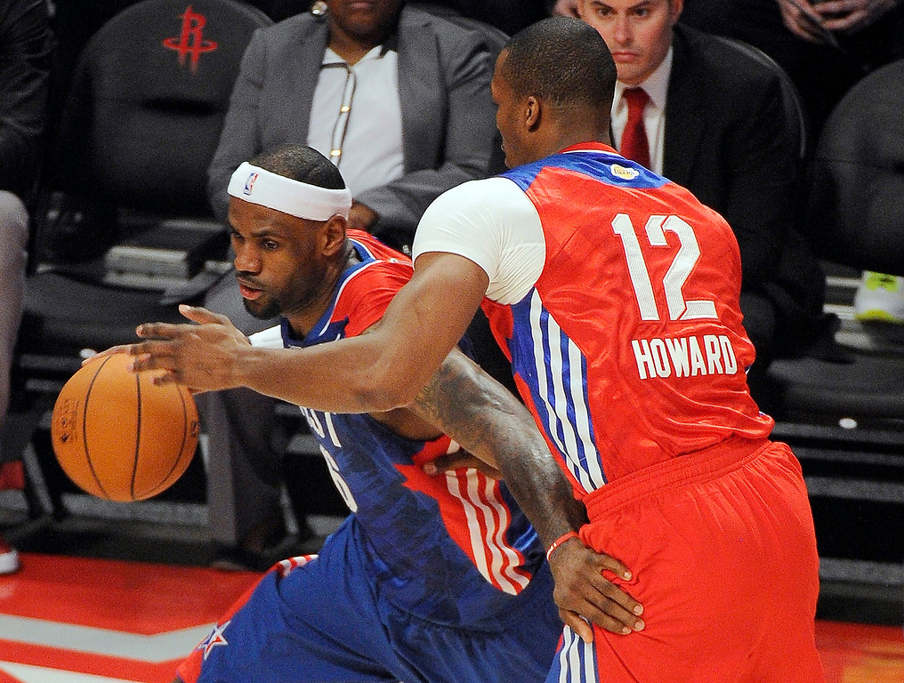 . East Team\'s LeBron James of the Miami Heat, left, is guarded by West Team\'s Dwight Howard of the Los Angeles Lakers during the first half of the NBA All-Star basketball game Sunday, Feb. 17, 2013, in Houston. (AP Photo/Pat Sullivan)