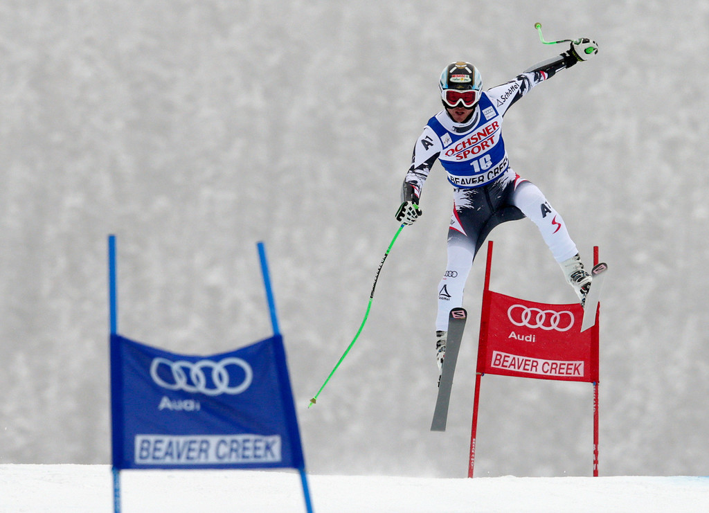 . Austria\'s Hannes Reichelt flies off the Red Tail jump during the men\'s World Cup super-G skiing event, Saturday, Dec. 7, 2013, in Beaver Creek, Colo. Reichelt finished tied for third place with Italy\'s Peter Fill. Switzerland\'s Patrick Kueng won the race and Austria\'s Otmar Striedinger finished second(AP Photo/ Charles Krupa)