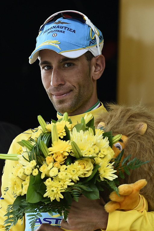 . Italy\'s Vincenzo Nibali celebrates his overall leader yellow jersey on the podium at the end of the 124.5 km seventeenth stage of the 101st edition of the Tour de France cycling race on July 23, 2014 between Saint-Gaudens and Saint-Lary Pla d\'Adet, southwestern France.  AFP PHOTO / ERIC FEFERBERG/AFP/Getty Images