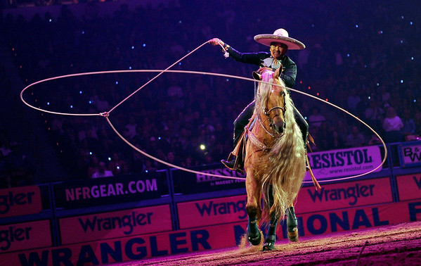 PHOTOS: Broncos, bulls and wranglera at National Finals Rodeo, in Las Vegas