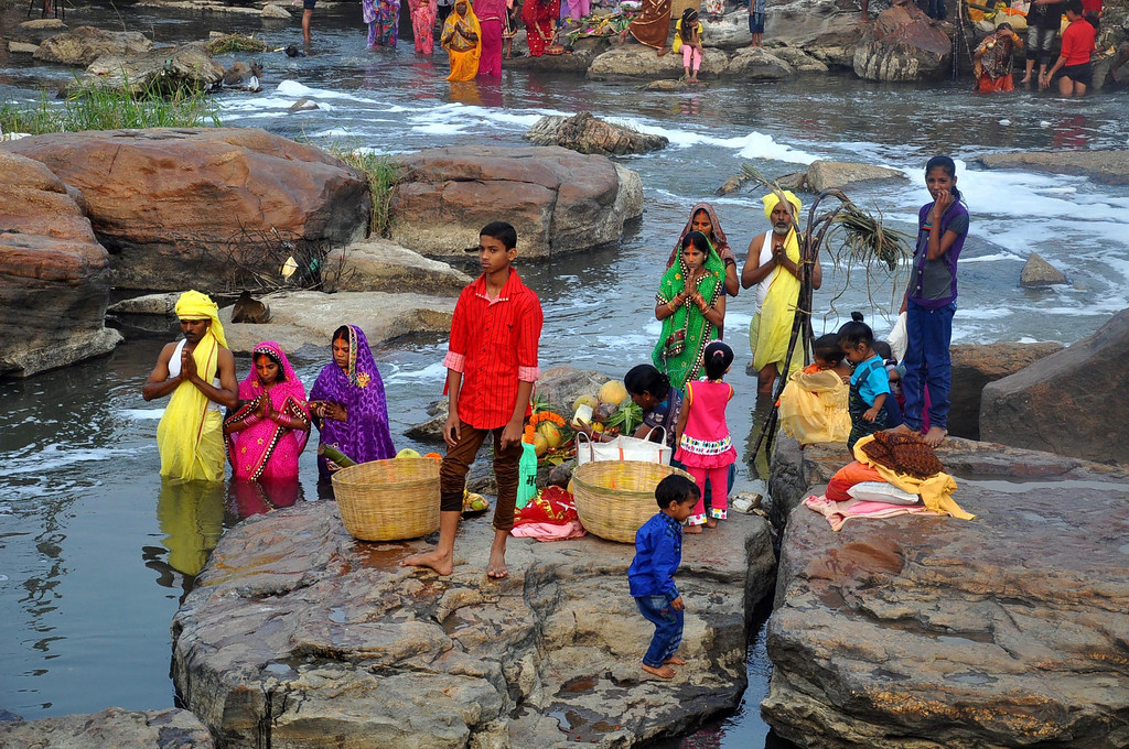 . Hindu devotees perform rituals to the setting sun in the Swarnrekha River during Chhath Puja festival in Ranchi, India, Friday, Nov. 8, 2013. (AP Photo/Sasanka Sen)