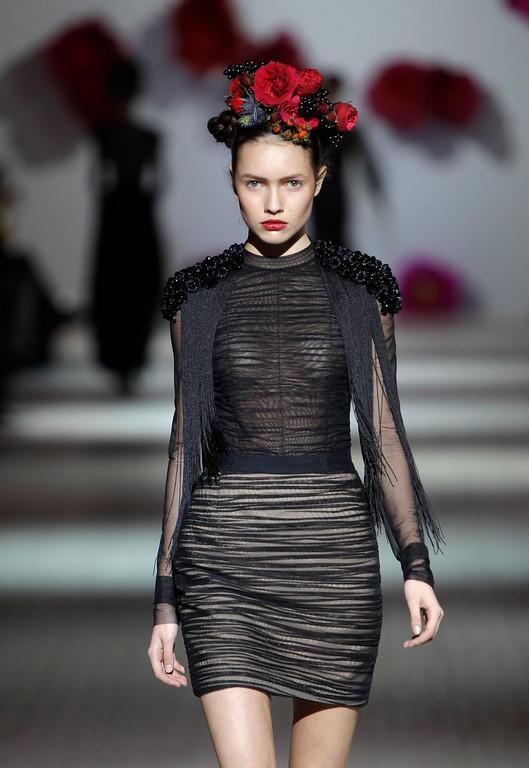 . EDS NOTE: NUDITY - A model displays outfits by Georgian designer Anouki Bicholla during Ukraine Fashion Week in Kiev, Ukraine, Sunday, Oct. 13, 2013. (AP Photo/Sergei Chuzavkov)
