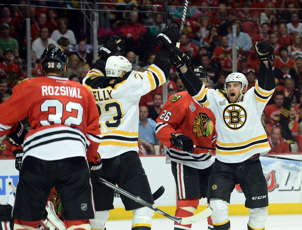 . CHICAGO, IL - JUNE 15:  Chris Kelly #23 of the Boston Bruins celebrates with teammate Daniel Paille #20 after scoring a goal in the second period to tie the game up against Corey Crawford #50 of the Chicago Blackhawks in Game Two of the NHL 2013 Stanley Cup Final at United Center on June 15, 2013 in Chicago, Illinois.  (Photo by Harry How/Getty Images)