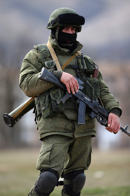 . Russian military personnel surround a Ukrainian military base on March 19, 2014 in Perevalnoe, Ukraine. Russia\'s Constitutional Court ruled unanimously on March 19 that Russia\'s President Vladimir Putin acted legally by signing a treaty to make Crimea part of Russia.  (Photo by Dan Kitwood/Getty Images)
