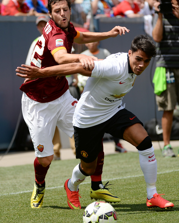 . James Reece of Manchester United (41), right, and Mattia Destro of AS Roma (22) are fighting for the control of the ball during 1st half of the game at Sports Authority Field at Mile High in Denver, Colorado, July 26, 2014. (Photo by Hyoung Chang/The Denver Post)