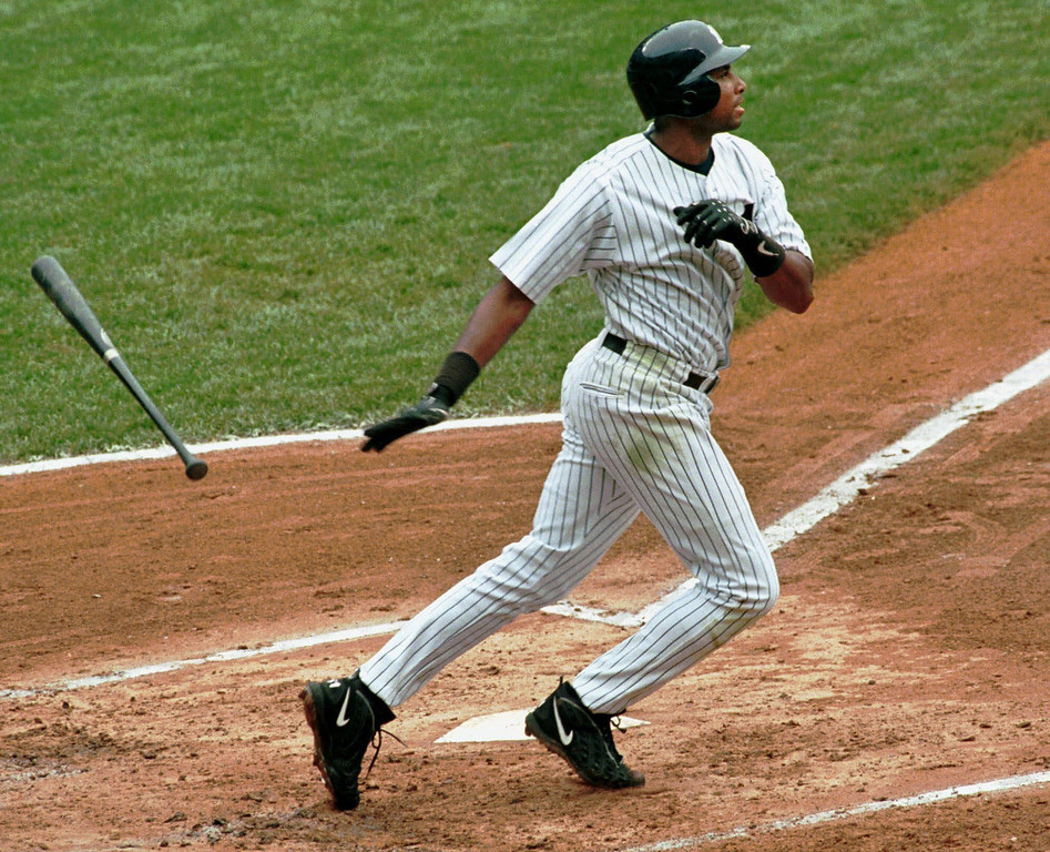 . BERNIE WILLIAMS -- New York Yankees\' Bernie Williams flips the bat away as he watches his two-run home in the first inning against the Tampa Bay Devil Rays on July 22, 1999, at Yankee Stadium in New York.     (AP Photo/Lou Requena)
