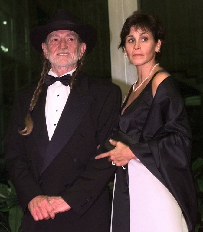 . Award winner Willie Nelson and his wife arrive at the Department of State for the Kennedy Center Honors Gala dinner Saturday, Dec. 5, 1998, in Washington.  The center honored comedian Bill Cosby, musician Willie Nelson, composer and conductor Andre Previn, songwriting team of Fred Ebb and John Kander, former actress and ambassador to Czechkoslovakia Shirley Temple Black.  No name given for Ms. Nelson. (AP Photo/Khue Bui)