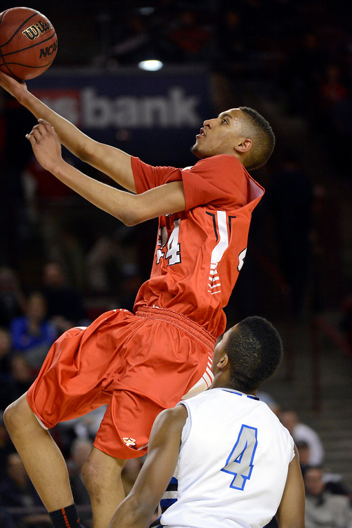 . DENVER, CO. - FEBRUARY 09: Dominique Collier (24) of East goes up for an easy layup past  Jalen Kittrell (4) of Highlands Ranch February 9, 2012 at Magness Arena.  East defeated Highlands Ranch 73 - 54. (Photo By John Leyba/The Denver Post)